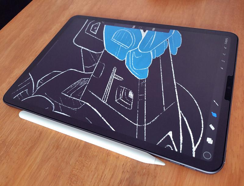 ipad with apple pencil drawing on procreate